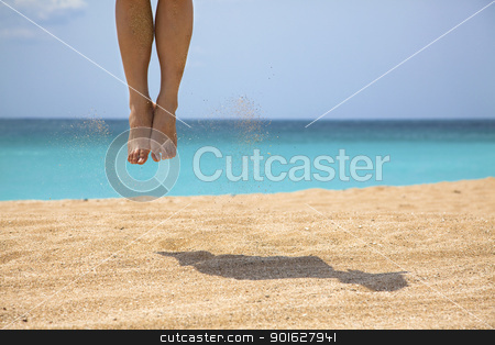 Man jumping on the beach stock photo, Man jumping on the beach by tomwang