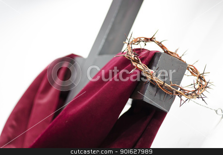 Cross and crown stock photo, Crown of thorns hung around the Easter cross by manaemedia