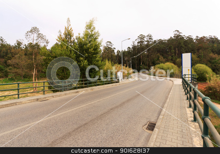 City Road stock photo, City scenic of an road through woods on cloudy day  by Paulo M.F. Pires