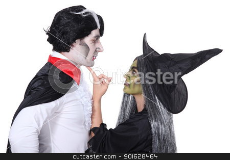 Couple dressed as witch and vampire stock photo, Couple dressed as witch and vampire by photography33