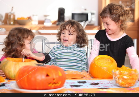 Three sisters carving pumpkins. stock photo, Three sisters carving pumpkins. by photography33