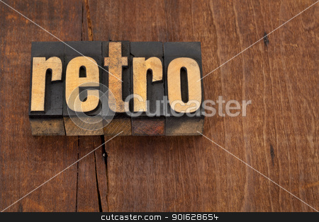 retro word in letterpress type stock photo, retro word in vintage letterpress type against grunge wood surface by Marek Uliasz