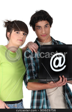 Teenagers surfing the internet stock photo, Teenagers surfing the internet by photography33