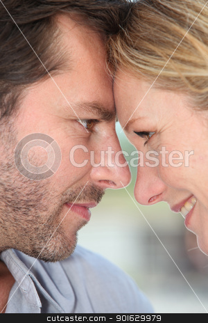 Couple with heads together stock photo, Couple with heads together by photography33