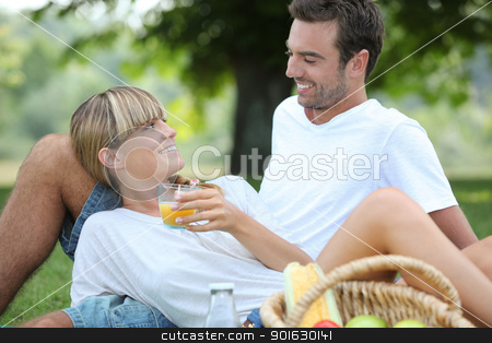 Couple relaxing on the grass stock photo, Couple relaxing on the grass by photography33