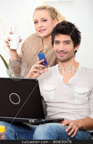 Couple doing online shopping. stock photo, Couple doing online shopping. by photography33