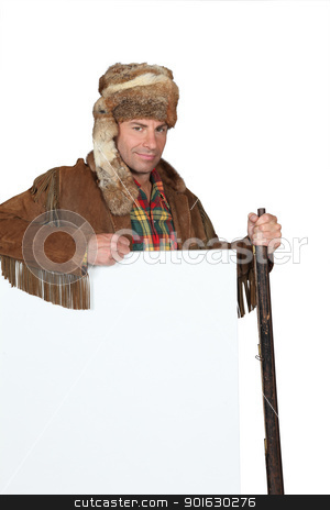 Man in an Western costume with raccoon skin hat and blank board ready for text or image stock photo, Man in an Western costume with raccoon skin hat and blank board ready for text or image by photography33
