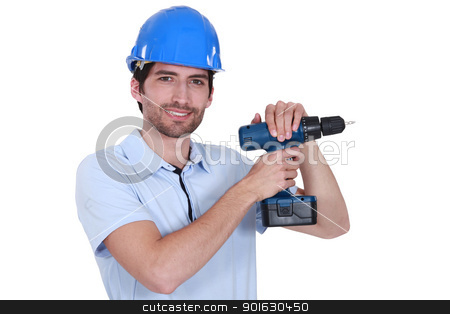 Man with helmet and drill stock photo, Man with helmet and drill by photography33
