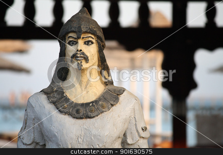 Ancient warrior stock photo, An ancient warrior statue in front of a gate by Daniele Cucchi