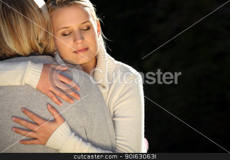 A mother and her teenage daughter hugging. stock photo, A mother and her teenage daughter hugging. by photography33