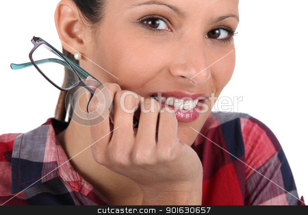 Young woman holding a pair of eyeglasses stock photo, Young woman holding a pair of eyeglasses by photography33