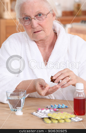 Older woman taking medicine stock photo, Older woman taking medicine by photography33