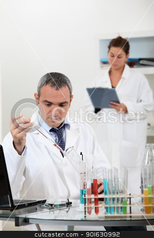 a scientist using test tubes stock photo, a scientist using test tubes by photography33