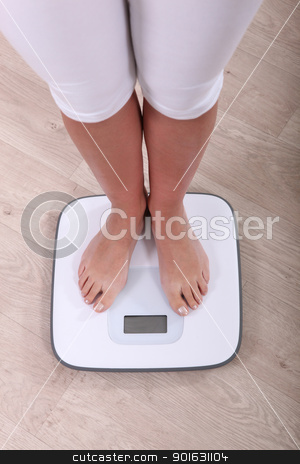 woman weighing herself stock photo, woman weighing herself by photography33