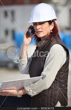 Female site manager using radio to communicate stock photo, Female site manager using radio to communicate by photography33