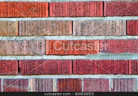 Red Brick Wall stock photo, Vibrant multi color red brick wall pattern  by Henrik Lehnerer