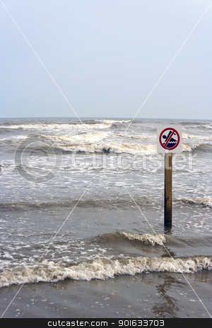 No Swimming stock photo, A no swimming sign at the beach with rough surf  by Kevin Tietz