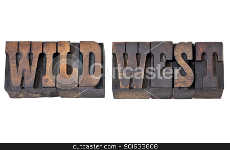 wild west in letterpress type stock photo, wild west - isolated text in vintage letterpress wood type - French Clarendon font popular in western movies and memorabilia by Marek Uliasz