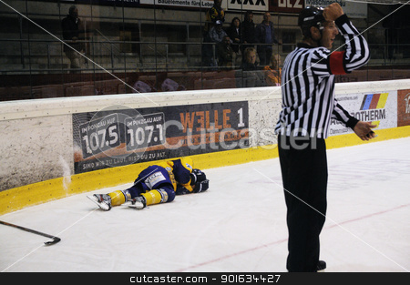 icehockey game action stock photo, ZELL AM SEE; AUSTRIA - OCT 2: Austrian National League. A Player of EK Zell am See got hurt during the game. Game between EK Zell am See and ATSE Graz (Result 2-3) on October 2, 2011 in Zell am See by www.ericfahrner.com