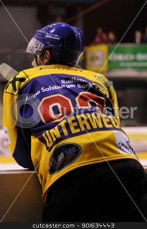 icehockey game action stock photo, ZELL AM SEE; AUSTRIA - AUG 30: Austrian National League. Clemens Unterweger of Zell am See on the players bench. Game EK Zell am See vs KAC II (Result 2-3) on August 30, 2011 in Zell am See. by www.ericfahrner.com