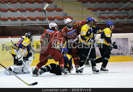 icehockey game action stock photo, ZELL AM SEE; AUSTRIA - AUG 30: Austrian National League. Fight in front of the net of EK Zell am See. Game EK Zell am See vs KAC II (Result 2-3) on August 30, 2011 in Zell am See. by www.ericfahrner.com