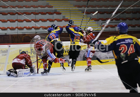 icehockey game action stock photo, ZELL AM SEE; AUSTRIA - AUG 30: Austrian National League. Philip Putnik number 12 of Zell am See (blue jersey) scored against KAC II. Game EK Zell am See vs KAC II (Result 2-3) on August 30, 2011 in Zell am See. by www.ericfahrner.com