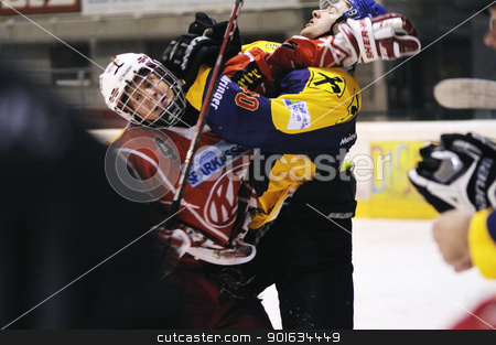 icehockey game action stock photo, ZELL AM SEE; AUSTRIA - AUG 30: Austrian National League. Fight in front of the bench of EK Zell am See. Game EK Zell am See vs KAC II (Result 2-3) on August 30, 2011 in Zell am See. by www.ericfahrner.com