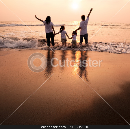 happy family  holding hands on beach and watching the sunset stock photo, happy family  holding hands on beach and watching the sunset by tomwang