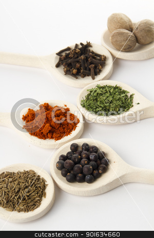 spices assortment stock photo, spices on wooden spoons in detail by FranziskaKrause