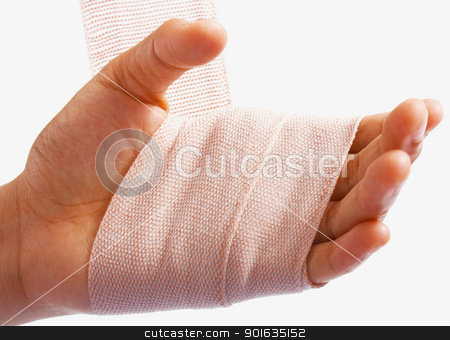 Hand Being Bandaged As Injury stock photo, Hand Being Bandaged After A Small Injury by stuartmiles