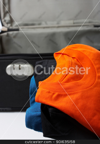 Packing Suitcase For A Trip stock photo, Packing Suitcase For Business Trip Or Holiday by stuartmiles