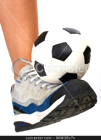 Soccer Ball Being Kicked By A Kid stock photo, Sporty Person Kicking A Soccer Ball by stuartmiles