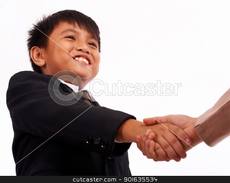 Formal Boy Shaking Hands With An Adult stock photo, Boy In A Formal Suit Shaking Hands With Someone by stuartmiles