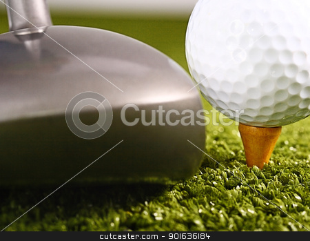 Golfer About To Drive A Golf Ball stock photo, Golfer On A Golf Course About To Drive A Golf Ball by stuartmiles