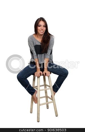 Casual Brunette on a Barstool (1) stock photo, A lovely young smiling brunette in casual wardrobe sits on a barstool, isolated on a white background with generous copyspace. by Carl Stewart