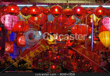 Storefront Display of Chinese New Year Lanterns stock photo, Storefront Displays of Chinese New Year Lanterns and Lion Dance along Street in Chinatown by Jit Lim