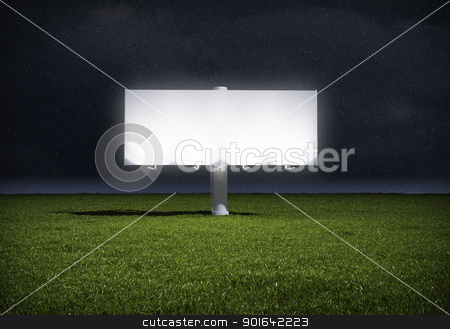 Ad billboard stock photo, Ad billboard standing in a field of grass - night version by Mopic