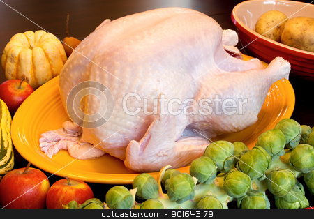Thanksgiving Turkey Dinner Cooking Ingredients on Wood Table stock photo, Thanksgiving Turkey Dinner Cooking Ingredients with Squash Apples Brussels Sprouts Pears and Potatoes on Kitchen Table by Jit Lim