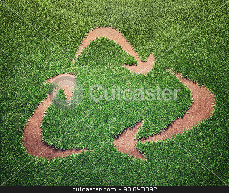 Recycling symbol  stock photo, Recycling symbol in a field of grass by Mopic