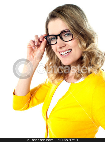 Smiling caucasian woman wearing and holding her glasses stock photo, Smiling caucasian woman wearing and holding her glasses on white background by Ishay Botbol
