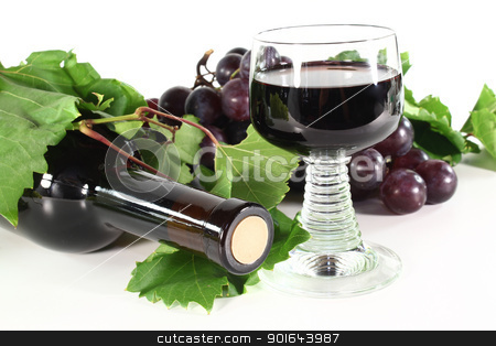 red wine with glass stock photo, a bottle of red wine with glass, grapes and vine tendril on a white background by Marén Wischnewski