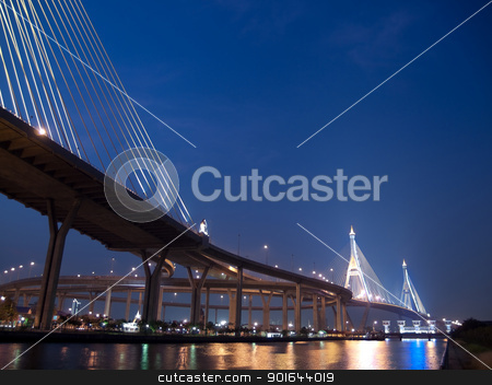 Part of Bhumibol Bridge stock photo, Bhumibol Bridge also casually call as Industrial Ring Road Bridge with floodgate illuminate with spotlight at night scene, Samut Prakarn,Thailand by Exsodus