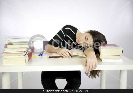 Lazy girl falls asleep while studying  stock photo, Lazy girl falls asleep while studying surrounded by books by federico marsicano
