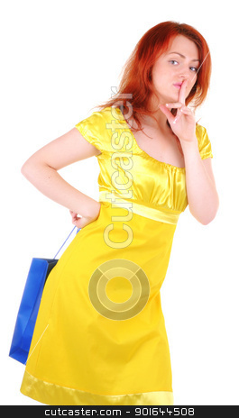 I have a nice surprise stock photo, Young beautiul woman with blue paper bag behind her back shows gesture to be quiet. by Iryna Rasko