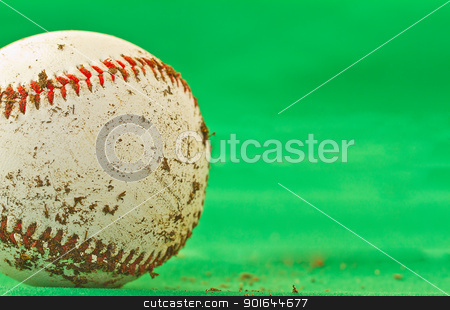 Baseball stock photo, A dirty baseball over a green background by Fabio Alcini