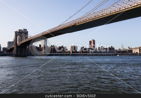 Brooklyn Bridge towards midtown manhattan stock photo, Empire State Tower visible under span of Brooklyn bridge in NY by Steven Heap