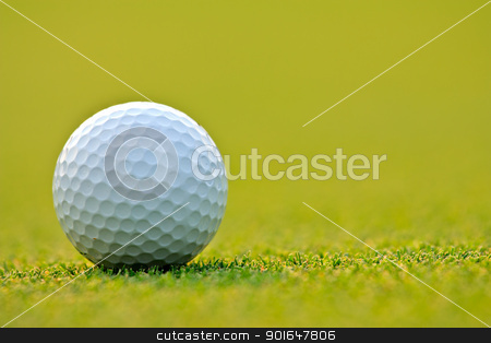 Golf ball on green grass stock photo, Golf ball on green grass by Sura Nualpradid