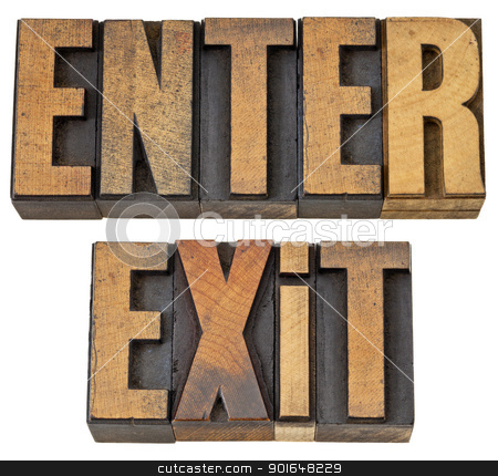 enter and exit words in wood type stock photo, enter and exit -  isolated words in vintage letterpress wood type by Marek Uliasz
