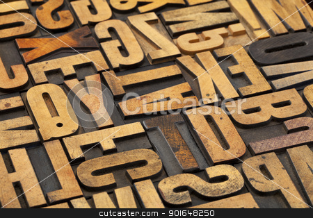 antique wood alphabet abstract stock photo, alphabet abstract in vintage letterpress wood type with ink patina by Marek Uliasz