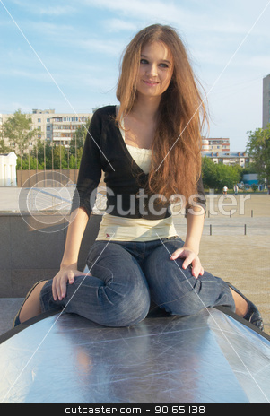 Young beautiful woman stock photo, Young pretty woman sitting at urban background by Aikon